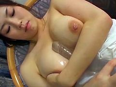 Watch this sexy busty Japanese babe spreading her legs and toying her hairy pussy while playing with her big heavy tits.See who she rubs those big fun bags and fingers her hairy pussy
