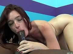 Passionate chick gives a blowjob in an interracial sex video. After that she toys her pussy with vibrator and gets fucked rough on a bed.