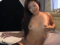 Asian chick in stockings and high heels lies on a bed. She plays with her shaved pussy and then gets fucked in reverse cowgirl pose. Lucy gets her mouth filled in the end.