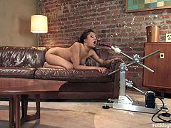 Petite Asian bitch Annie Cruz is having fun with her new fucking machine indoors. She rubs her snatch first and then grabs the attachment and drives it deep into her ass.