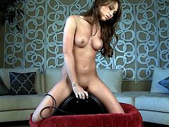 Dazzling beauty rides her new toy with great pleasure in hot solo scene