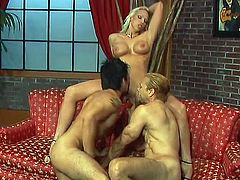 A gorgeous blonde is having fun with two bisexual studs. She shows her cock-sucking talent to the dudes and then gets fucked in missionary and other positions.