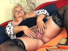 Vratislava is a Czech plumper with huge boobs. She pumps her unshaven cunt with a black toy while laying on her back and she does the same when she's on all fours.