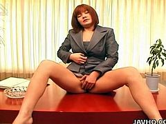 Anna Yumisaki rubs her hairy pussy before the camera. This naughty Japanese mom gives us a glimpse of her supreme naughty moves in the office for your satisfaction.