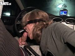 Marga is a horny babe wearing a blindfold as she sucks on this guy's hard cock while she's on the passenger seat as he drives.