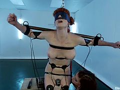 Gia Dimarco ties up and blindfolds pigtailed Audrey. Then the redhead girl gets wired and toyed with a vibrator.
