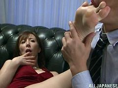 This Japanese milf has whored herself out to a rich Japanese salaryman. He sticks his hand down into her pink panties as he kisses her neck. She gets a pink dildo shoved into her cunt. He squeezes her tits while he thrusts the dildo inside her. He takes off her high heels and sucks all of her toes.