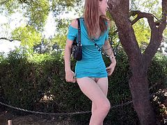 Take a look at this redhead teen's great ass and her tight pink pussy as she loses her shorts and uses her shirt as a dress in public.