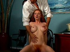 Long-haired redhead bitch Annie Body is having fun with some guy in an office. She sucks the dude's weiner and then leans against the desk and gets her hairy cunt pounded from behind.