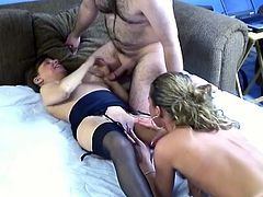 Cougar brunette wearing sexy lingerie and stockings gets cozy and enjoys pussy eating by one cute amateur chic. She spreads her pussy labia and dives in her slit.