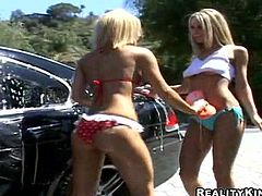 Three awesome blondes make lesbian love after washing a car