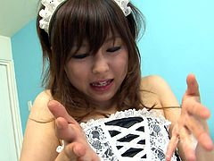 Cute Japanese maid does her best while polishing two poles attacking her face. She jerks off one cock and sucks another one at the same time.