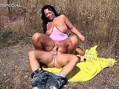 Check out this hardcore scene where a sexy mature brunette is fucked silly by this guy outdoors as you take a look at her big natural tits.