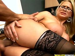 Have fun watching this MILF, with giant fake breasts wearing back stockings and sexy glasses, while she gets banged hard! Alanah really likes big dicks!