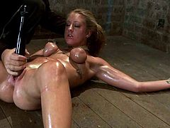 What a desirable and kinky siren Lizzy London is! She gets oiled up and babe get nailed on the floor to be bondaged!