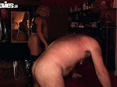 Check it out, somebody is having fun around here! The fat, hairy dude enjoys a mean bdsm session with a very skilled mistress. The whore whips him and then drips hot wax on his dick. This seems kinky enough to deserve our attention!