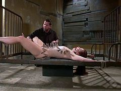 Check this nasty redhead being helpless. She is tied up to a bed with her asshole wide open and a mean dude plays bondage games with her.