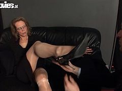 Watch this mature blonde playing with her husband as she humiliates and tortures him in this femdom clip.