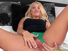 This amazing fuckin' whore sucks on this dude's hard dick and then the fucker gets it shoved balls deep into her fuckin' gash!