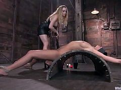 Aiden Starr tortures Devi Emerson before fucking her with a strapon