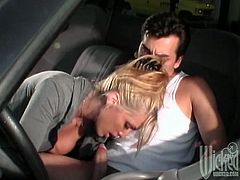 As her husband picks her up with the car, she feels hungry for his cock. With him behind the wheel, she sucks him until he cums inside her mouth.
