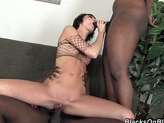 She seduces these black guys with her cute face and hot ass and then they pumps her tiny cunt and make her scream of pleasure that they gives her.