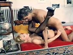 Thrilling blonde hooker in stockings and corset gives some head and then gets her soaking wet hairy snapper furiously fucked in missionary and doggy poses.