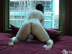 Sinfully brunette babe Sarah toying her tight pussy and ass at the window