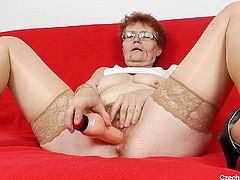Czech granny Jindriska has a tight pussy between her legs that needs some serious stretching. Here she is on the red couch getting naughty with her big dildo. The cougar begins to suck her sex toy and then shovels it in her pussy. She changes position and fucks herself from behind. Damn, this bitch really needs it!