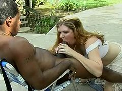 Sugar Kane is cougar who loves blowing big black cocks. He comes in his neighbor garden and give him great deepthroat fellatio.