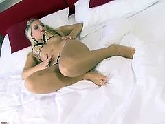 Karup's Private Collection brings you a hell of a free porn video where you can see how the gorgeous blonde Bella Bell fingers her cunt into heaven on her bed.