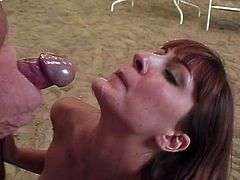 Lustful mom is having fun with some guy in a stable. She gives a blowjob to the dude and then they bang in cowgirl, missionary and other positions on the sand.