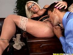 Enjoy this blonde pornstar, with great bazookas wearing sexy glasses and stockings, getting banged over a desk! Sadie is a freak for sure!