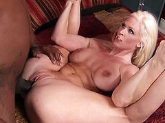 A fuckin' slutty blonde bitch sucks on a black dude's big black cock and then takes it balls deep into her fuckin' gash, check it out!