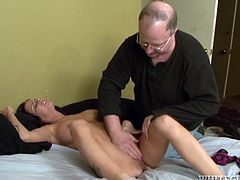 Gorgeous brunette Brandy Aniston wearing lingerie allows some guy to rub her nice pussy. Then she strips and takes the fucking machine attachment into her pussy.
