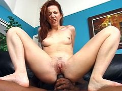 Have fun watching this redhead, with natural knockers and a shaved pussy, while she gets nailed hard by a tattooed dude. Trinity loves dark meaty sticks!