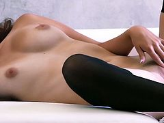 Watch the sexy brunette belle Natasha Malkova taking her clothes off before rubbing her shaved pussy into kingdom come while wearing black stockings.