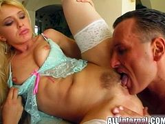 What are you waiting for? Watch a steamy brunette and a hot blonde, wearing sexy lingerie and white stockings, while a man bangs them in the living room.
