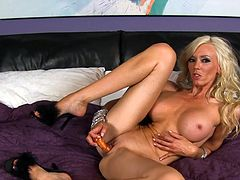 Slim blonde with big boobs Demi Dantric likes to pose when masturbating her cunt