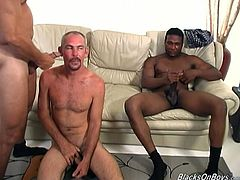 This white guy gets his fill of black cock when he hooks up with two ebony studs and lets them both fuck him and cum on his face.