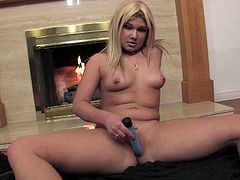 This cute little chubby blonde Aubrey Addams lays down on the floor in front of the fireplace and goes solo with her vibrator in this free tube video.