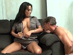 Stunning shemale takes clothes off. The guy licks TS Foxxy's tits and ass. Later on the guy stats to suck a dick and lick balls.