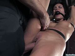 Lewd dark-haired chick Ruby Knox allows Steve Holmes to put her into irons. Steve torments the slut and then pounds her juicy vag from behind.