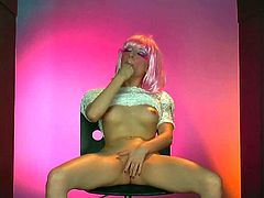 Slender bitch Ashy Jane with long legs and kinky make in stripper shoes and white blouse pretends to be Lady Gaga and stuffs shaved twat with toy in arousing parody.