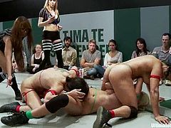 Girls in red and green bikinis fight in a ring. Green team loses a fight, so they lick pussies and also get fingered by girls from the red team.