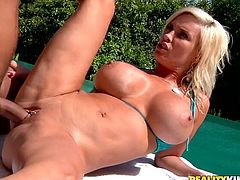 Click to watch this blonde MILF, with immense tits wearing a sexy bikini, while she goes hardcore with a steamy fellow. She loves having a big cock inside!