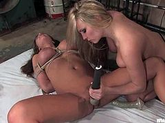 Sexy brown-haired babe gets chained and gagged by her mistress. Later on she gets her vagina toyed with a vibrator and a strap-on.
