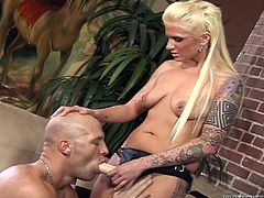 Christian XXX is having fun with dominant blonde Monroe Valentino. He sucks the girl's strapon and then takes it in his butt and gets fucked in missionary position and doggy style.