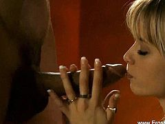 It looks like this beautiful blonde is worshiping cock judging by the way she is gently touching it. She gives a slow blowjob and uses her hands to massage his shaft as well.