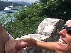 This naughty couple was on holiday and they wanted to film it all. She was so horny and start wanking his dong and he filmed it.